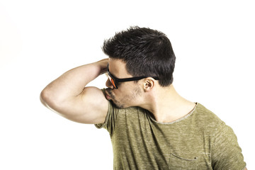 handsome young man kissing his biceps