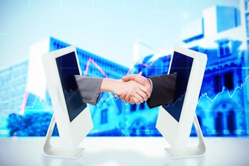 Composite image of close up of businesspeople shaking hands