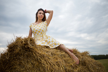 barefoot girl in the hayloft