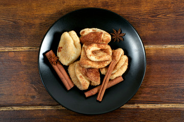 Biscuits with sugar and cinnamon sticks from top