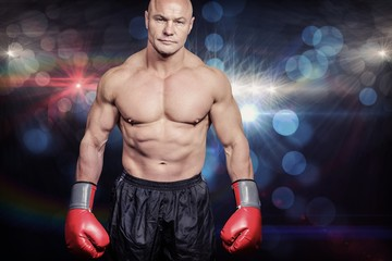 Composite image of portrait of bald man with boxing gloves