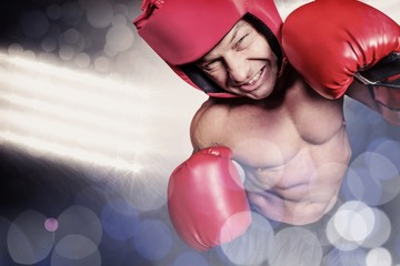 Composite image of high angle view of boxer with headgear