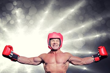 Composite image of winner boxer with arms outstretched