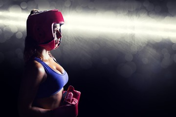 Composite image of side view of female boxer with headgear