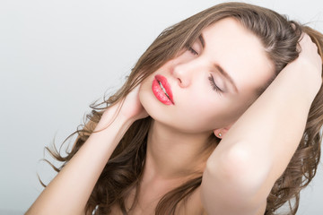 close-up portrait of a beautiful brunette girl with red lips, expresses different emotions