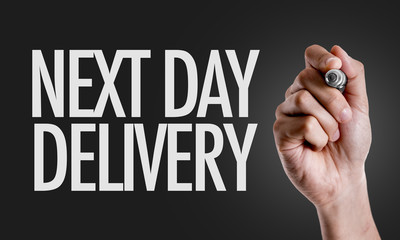 Hand writing the text: Next Day Delivery