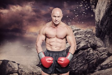 Composite image of portrait full length of bald boxer