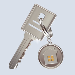 Silver key and round key chain with house on blue background