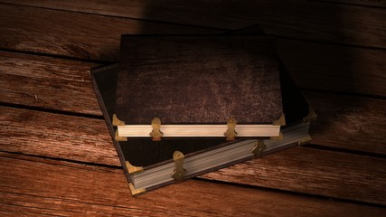 two old leather books with metal claps on wooden table