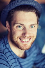 happy young man in hipster hat