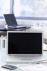 Closeup photo of open laptop in office