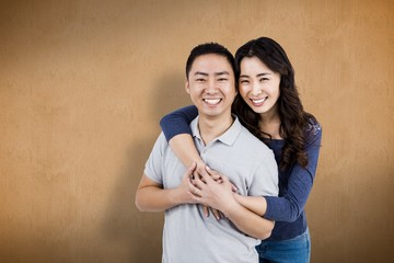 Composite image of portrait of cheerful couple