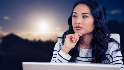 Composite image of thoughtful asian woman with finger on chin