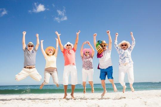 Happy senior friends jumping