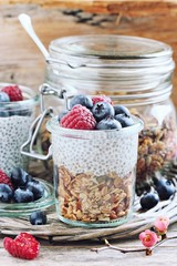 Superfoods concept : overnight chia pudding with homemade granola,fresh berries and honey. Healthy eating. Selective focus