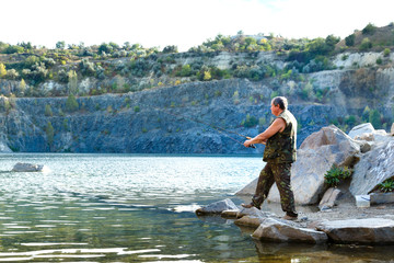 Fisherman on a mountain lake