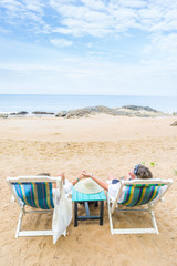 Couple on their honeymoon at the beach