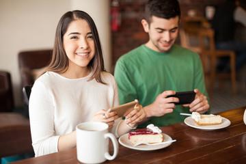 Couple taking photos of their food
