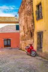 red scooter in narrow street