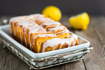 Lemon yogurt loaf cake, sliced on plate