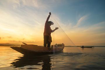 Fisherman fishing at lake in Morning, Thailand..