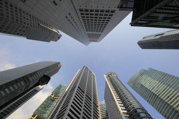 Wall Murals Skyscrapers in Singapore. Highrise buildings ,City view with wide angle lens, looking straight up.
