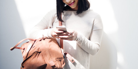 Asian Lady Checking Phone Bag Wall Concept