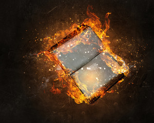 Book with blank pages in fire