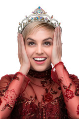Woman in total happiness after winning beauty pageant in red gown perfect smile white teeth tiara