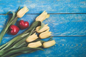 Yellow tulips on a blue wooden rustic table