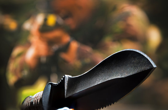 Acute new soldier's knife close-up