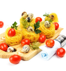 Pasta nests with cherry tomatoes and quail eggs.