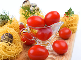 Glass Gravy boat with tomatoes.