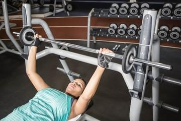 Woman using weight machines