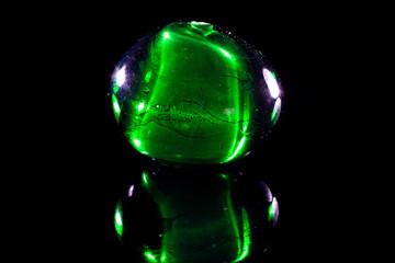 Clear green glassy bead