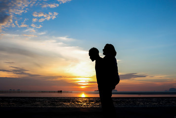 Silhouette of loving couple .