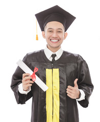 young graduation man smiling while holding diploma and giving th