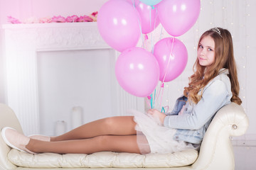 Pretty teen girl with many pink balloons