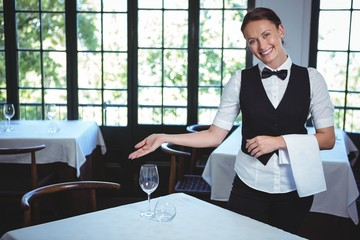 Waitress showing a table in a restaurant