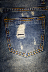 Old pocket blue jeans dirty at torn for background.