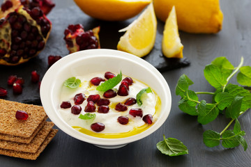 The sauce (dip) of yogurt with pomegranate and mint