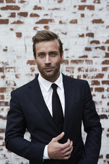 Handsome businessman in black suit, portrait