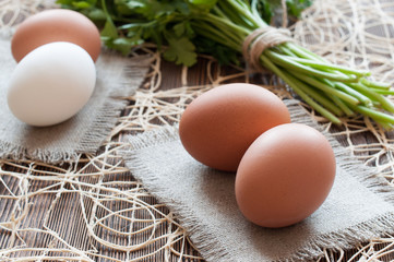 Chicken eggs and parsley