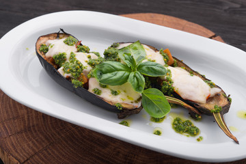 Baked eggplant with cheese and basil