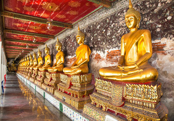 Rows of Buddha Images around temple in Wat Suthat Bangkok, Thail