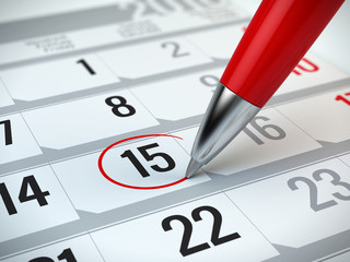 Concept of important day, reminder, organizing time and schedule - red pen marking day of the month on a calendar