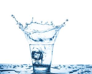 Water splash in glass on white background
