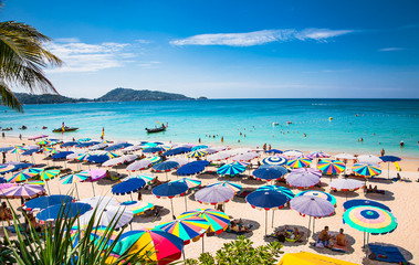 Crowds of tourists at Patong beach in Phuket, Thailand.