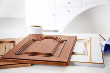 Samples of panels with imitation of wood for furniture and door on white table