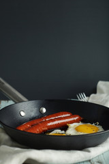 fried eggs with sausages. Rustic style